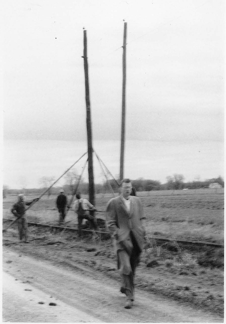 Historic image of putting up poles